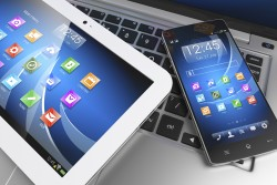Mobile devices. Tablet PC, smartphone on laptop, technology concept. 3D
